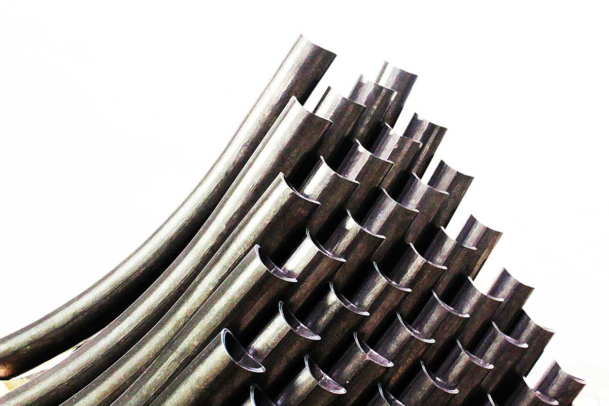 A series of steel tubes cut with the laser tube